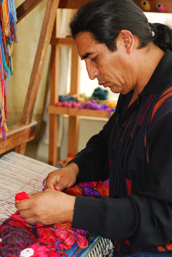 Maximo-Laura-weaving-on-the-loom